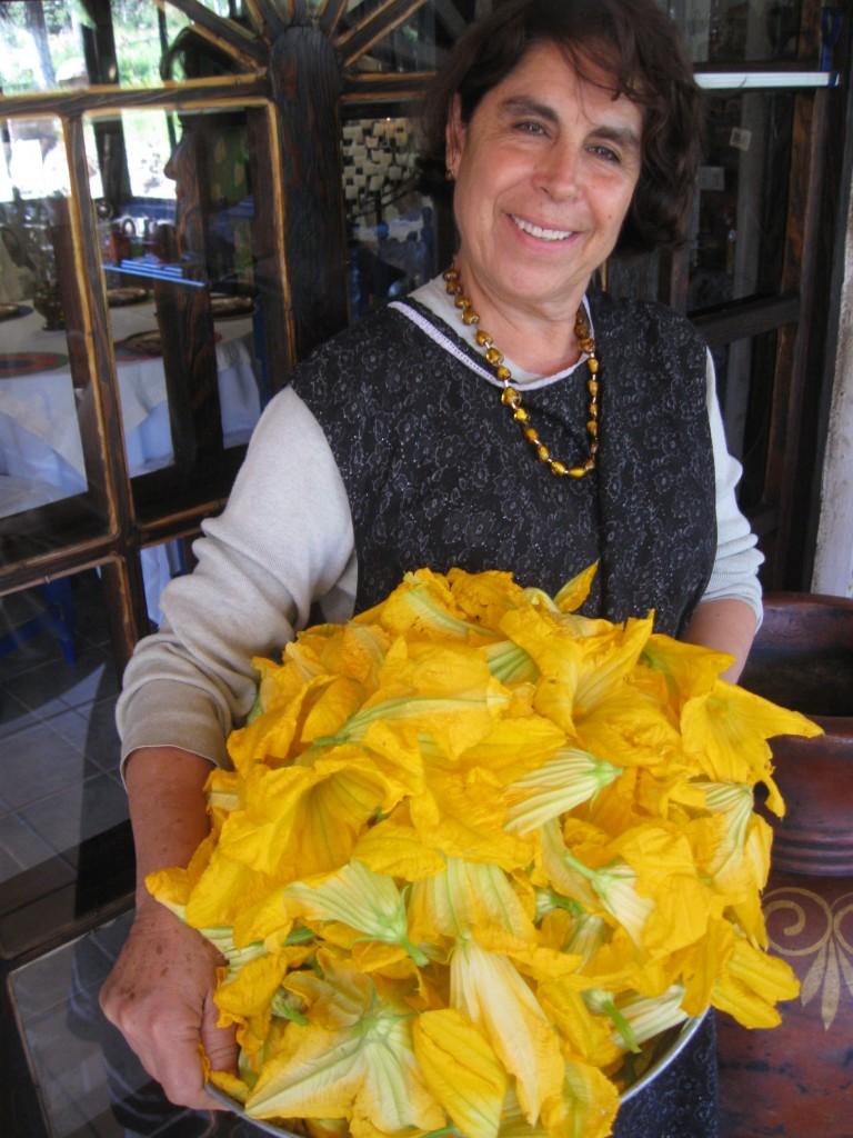 """Chef Sol at Noritari with her morning crop of flor de calabacitas...a regular stop on """"The Blue Corn Express""""."""
